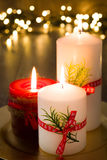 Red Christmas candle. And Christmas light Royalty Free Stock Photography