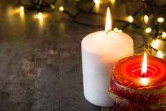 Red Christmas candle. And Christmas light Stock Image