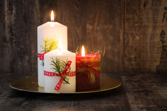 Red Christmas candle. And Christmas light Stock Photography