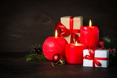 Red christmas candle. Present and decorations on dark background Stock Image
