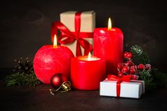 Red christmas candle. Present and decorations on dark background Royalty Free Stock Photos
