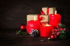 Red christmas candle. Present and decorations on dark background Royalty Free Stock Image