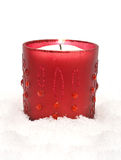Red christmas candle. On snow Royalty Free Stock Images