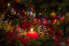 Red Christmas candle surrounded by pine branches Stock Images