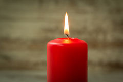 Red Christmas candle. On a white wooden background Stock Photo