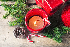 Red Christmas candle on wooden background. Red Christmas candle on a wooden background Stock Photography