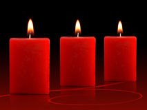 Red Christmas Candles. Three Red Candles in black and red background Stock Photo