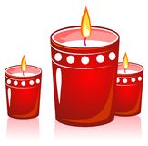 Red christmas candles. Three red stylized christmas candles isolated on a white background Royalty Free Stock Photo