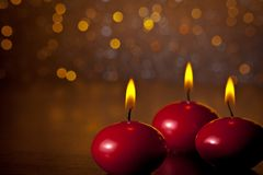 Red christmas candles on golden bokeh background Stock Photography