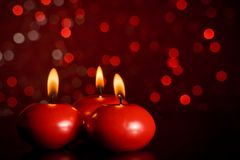 Red christmas candles on red bokeh background Royalty Free Stock Photo