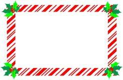 Red christmas candy cane border with holly. Royalty Free Stock Photos