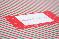 Red Christmas card. сhristmas striped background and seasonal greetings Royalty Free Stock Images