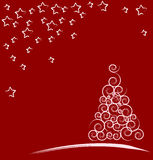 Red Christmas card. White Christmas Tree isolated on a red background Royalty Free Stock Photography