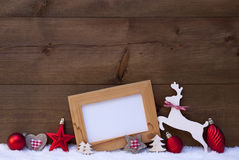 Red Christmas Card With Decoration On Snow, Copy Space Stock Images