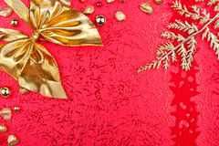 Red christmas card with golden ribbon Royalty Free Stock Photos
