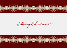 Red Christmas card with seamless swirly border Royalty Free Stock Photography