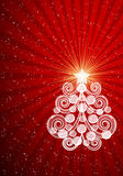 Red Christmas card with swirls tree and balls. Stock Photo