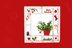 Red Christmas collage in window Royalty Free Stock Photos
