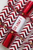 Red christmas cracker with fun phrase Royalty Free Stock Photography
