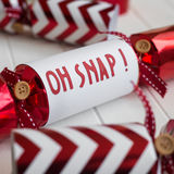 Red christmas cracker with fun phrase Stock Photo