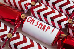 Red christmas cracker with fun phrase Royalty Free Stock Images