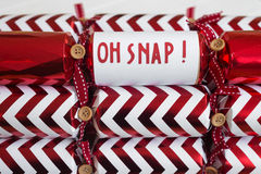 Red christmas cracker with fun phrase Stock Image