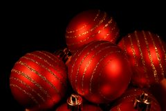 Red christmas decoration. Red christmas balls on black background Royalty Free Stock Photo