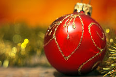 Red christmas decoration ball with garland Stock Image