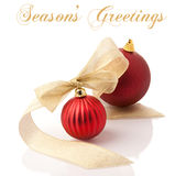 Red christmas decoration balls with gold ribbon Royalty Free Stock Images