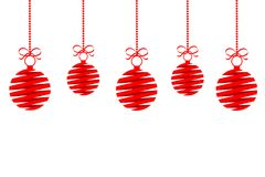 Red christmas decoration balls from ribbon with bow isolated han Royalty Free Stock Image