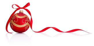 Red Christmas decoration bauble with ribbon bow isolated on white background stock photography