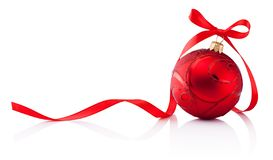 Red Christmas decoration bauble with ribbon bow isolated on white background stock images
