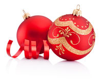 Red Christmas decoration baubles and curling paper isolated Stock Images