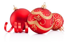 Red Christmas decoration baubles and curling paper isolated Stock Photography