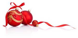 Red christmas decoration baubles with ribbon bow isolated. On white background Stock Photos