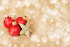 Red Christmas Decoration on a bokeh background with copyspace Stock Photo