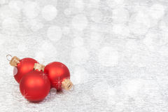 Red Christmas Decoration on a bokeh background with copyspace stock image