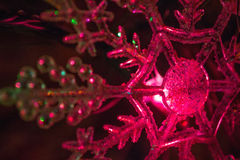 Red Christmas Decoration Close-Up. Decorative red snowflake christmas tree decoration close-up Stock Photography