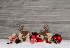 Red christmas decoration in country style with gift boxes, reind Stock Photos