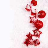 Red Christmas decoration covered with snow Royalty Free Stock Photo