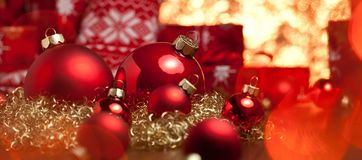 Red christmas decoration gifts and christmas tree deco.