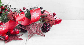 Red Christmas Decoration with Glitter Ribbon,Cones and Star Orn Stock Photos