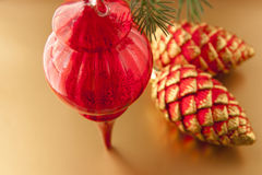 Red Christmas decoration on golden background Royalty Free Stock Photo