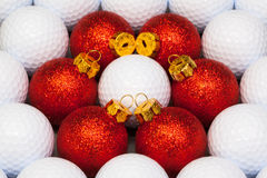 Red Christmas decoration between the golf balls Stock Photography