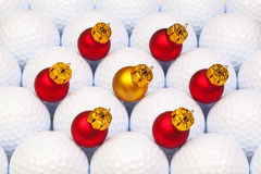 Red Christmas decoration between the golf balls Stock Photo