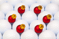Red Christmas decoration between the golf balls Stock Images