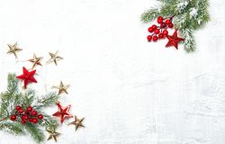 Red Christmas decoration green pine tree branches. Red Christmas decoration and green pine tree branches on white background royalty free stock images