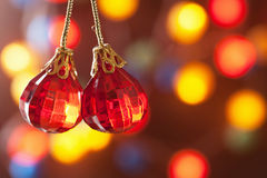 Red Christmas decoration over blurred background Stock Photography
