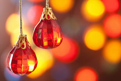 Red Christmas decoration over blurred background Royalty Free Stock Photography
