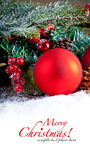 Red christmas Decoration Over Wooden Background. Royalty Free Stock Images